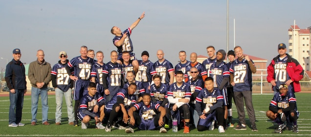CAMP HUMPHREYS, Republic of Korea – The U.S. Marine Corps Forces Korea flag football team participates in the Army versus the Navy & Marine Corps football game at Balboni Field here, Dec. 1. The Marines practiced every day for a total of 4 weeks in preparation for this highly anticipated game amidst the friendly inter-service rivalry.