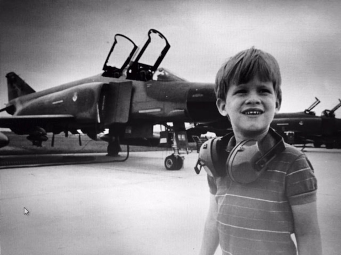 A young David L. Mueller in front of a F-4E Phantom at the New Jersey Air National Guard ramp at McGuire Air Force Base, N.J. in 1986.