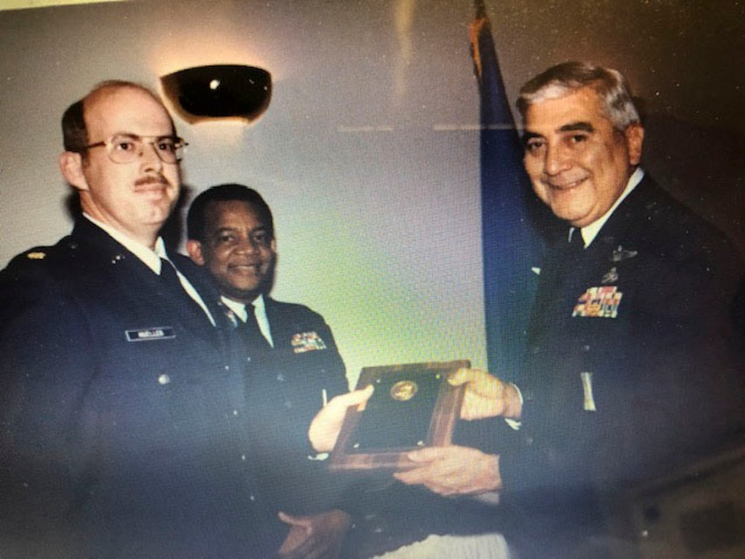 The late retired Lt. Gen. Leo Marquez presents the Air Force level Company Grade Maintenance Officer of the Year award to retired Col. Kent Mueller in 1986.