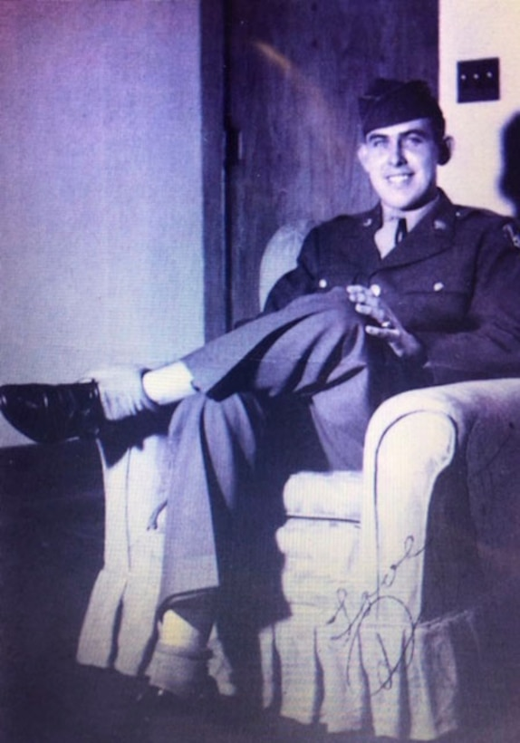 The late retired Col. Delbert L. Mueller poses for a photo at his home in Lebanon, Ill. before attending the Aviation Cadet Program in 1943.