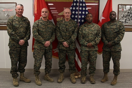 CAMP HUMPHREYS, Republic of Korea – Col. Sekou S. Karega, Camp Mujuk commanding officer, and 1st Sgt. Eric J. Thompson, Camp Mujuk senior enlisted advisor, visits Maj. Gen. Patrick J. Hermesmann, U.S. Marine Corps Forces Korea commander, and the MARFORK command team here, Nov. 29. Camp Mujuk is the only USMC installation in Korea.  Mujuk, meaning invincible, was the nickname earned by U.S. and R.O.K Marines who fought at Dosol Mountain during the Korean War. (Official Marine Corps photo by Sgt. Nathaniel Hanscom/Released)