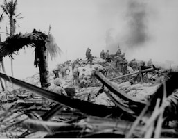 U.S. Marines storm Tarawa in the Gilbert Islands. Nov. 20, 2018 marks the 75th anniversary of the start of the Battle of Tarawa, which was part of Operation Galvanic. It marks one of the bloodiest battles of WWII. The 75th commemoration of the Battle of Tarawa is an opportunity to honor the courage, service and sacrifice of the U.S. military personnel present during the attacks. (U.S. Marine Corps Courtesy Photo by Warrant Officer Obie Newcomb, Jr.)