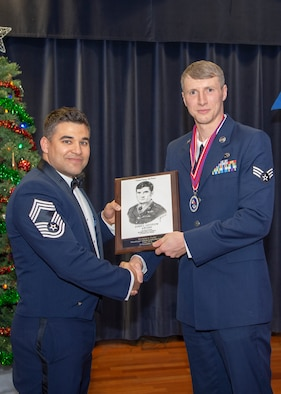 U.S. Air Force Senior Airman Dylan Fisher, 52nd Maintenance Squadron, receives the John L. Levitow during the Pitsenbarger Airman Leadership School 19-A graduation at Club Eifel on Spangdahlem Air Base, Germany, November 29, 2018. The Levitow award is the highest honor given to the student who displays excellence in all categories of ALS. (U.S. Air Force photo by Airman 1st Class Kyle Cope)