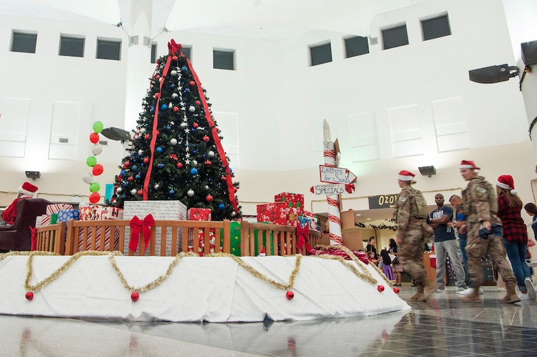 Service members and military families attend a holiday kick-off event Dec. 1, 2018, at Al Udeid Air Base, Qatar. Attendees were able to play holiday games, watch live music performances, and interact with Santa Claus during the event. (U.S. Air Force photo by Tech. Sgt. Christopher Hubenthal)