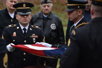New York Army National Guard Soldiers in the Honor Guard fold the U.S. flag during a funeral service for Pfc. John Martin in Schuylerville, N.Y., Dec. 2, 2018. Martin had gone missing in action during the Korean War at the battle of Chosin Reservoir. His family finally received his body after 68 years as listed missing.