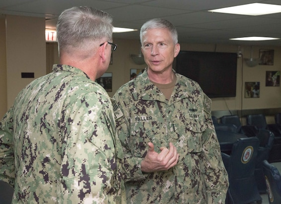 Adm. Craig Faller, commander, U.S. Southern Command (Center), and U.S. Navy Capt. William Shafley, commander, Task Force 49, exchange words aboard the hospital ship USNS Comfort (T-AH 20) during his visit to Colombia.