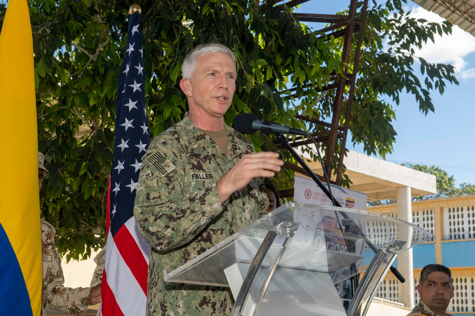 Adm. Craig Faller, commander, U.S. Southern Command, delivers remarks during the closing ceremony at a land-based medical site.