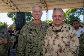 Adm. Craig Faller, commander, U.S. Southern Command, and Colombian Gen. Alberto Mejía, general commander, Colombian Military Forces, pose for a photo during the closing ceremony at a land-based medical site.