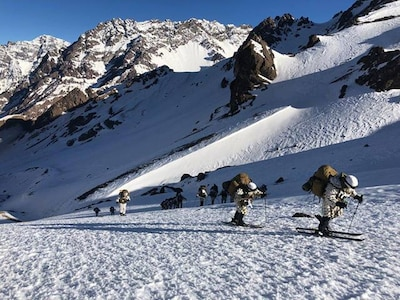 Students at the Chilean Mountain Warfare School ski uphill carrying their combat gear in the Chilean Andes as part of the winter portion of the course.