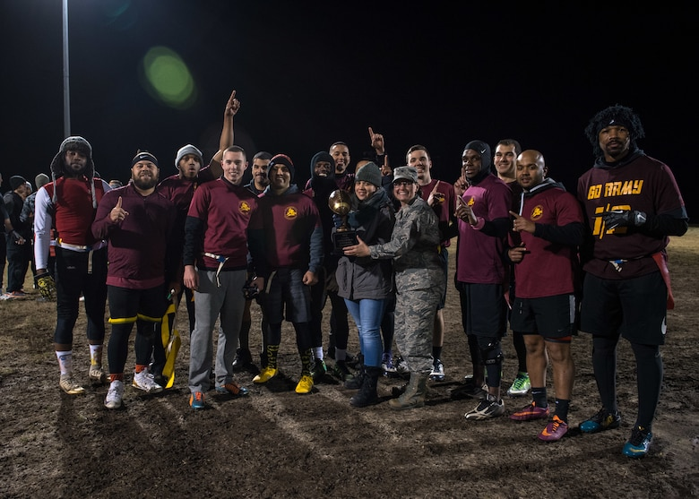 U.S. Air Force Col. Erin Cluff, 633rd Mission Support Group commander, hands the championship trophy to Airmen assigned to the 27th Intelligence Squadron during the intramural flag-football championship at Joint Base Langley-Eustis, Virginia, Nov. 27, 2018.