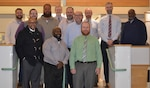 Men from the DLA Troop Support Subsistence supply chain pose for a photo to commemorate the final days of No Shave November, Nov. 28, 2018 in Philadelphia.  No Shave November is an annual campaign to bring awareness to cancer and encourage participants to donate the money typically used for shaving supplies to a local charity.
