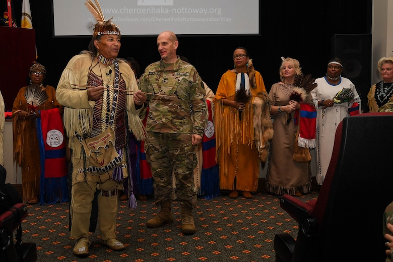 "Walter D. ""Red Hawk"" Brown III, Cheroenhaka (Nottoway) tribe chief, presents U.S. Army Maj. Gen. Paul Benenati, Training and Doctrine Command deputy chief of staff, with a peace arrow before beginning his presentation during the Native American Indian Heritage Month event at Joint Base Langley-Eustis, Virginia, Nov. 30, 2018. Brown explained that the peace arrow was used when entering another tribe's area of operations as a sign of peace. (U.S. Air Force photo by Senior Airman Derek Seifert)"