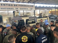 West Virginia Army National Guard Master Sgt. Ricky Baker discusses preventative maintenance checks and services of the M1165 HMMWV Nov. 28, 2018, with Peruvian Army maintenance personnel during a Subject Matter Expert Exchange (SMEE) Global Peace Operations Initiative (GPOI) mission held in Lima, Peru.