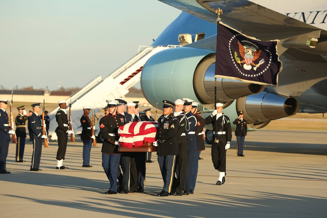 U.S. service members with the Ceremonial Honor Guard carry the casket of George H. W. Bush, the 41st President of the United States, at Andrews Air Base, Md., Dec. 03, 2018.