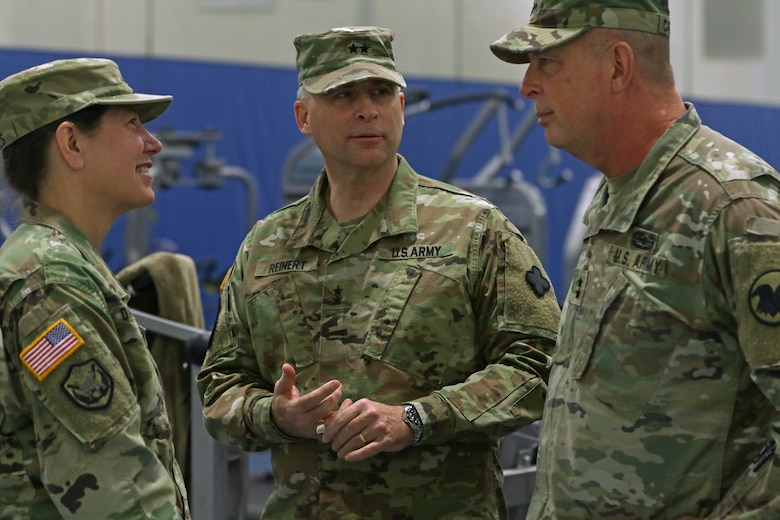 From left Maj. Gen. Jody J. Daniels, commanding general, 88th Readiness Division; Maj. Gen. Patrick J. Reinert, commanding general (outgoing), 88th Readiness Division; Maj. Gen. Scottie D. Carpenter, deputy commanding general, U.S. Army Reserve Command, talk backstage after the 88th Readiness Division change of command ceremony at Fort McCoy, Wisconsin, December 1, 2018.