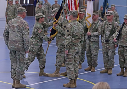 Maj. Gen. Jody J. Daniels, commanding general, 88th Readiness Division passes the unit colors to Command Sgt. Maj.  Jeffrey L. McGlin, senior enlisted advisor, 88th Readiness Division, entrusting the unit's safe keeping under arms, during the 88th Readiness Division change of command ceremony Dec. 1, 2018, at Fort McCoy, Wisconsin. The transfer of the colors from one commander to another is a symbolic transfer of command authority and responsibility from one commander to another.