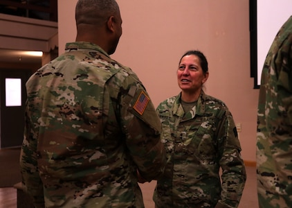 Maj. Gen. Jody J. Daniels, commanding general, 88th Readiness Division, greets Soldiers in a welcoming reception line after the change of command ceremony symbolizing her upcoming assumption of command at Fort McCoy, Wisconsin, December 1, 2018.