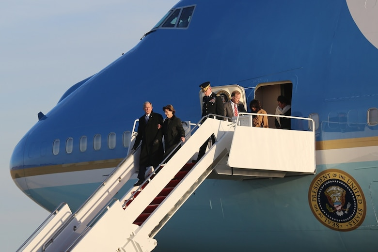 Bush family arrives for state funeral aboard Air Force One.