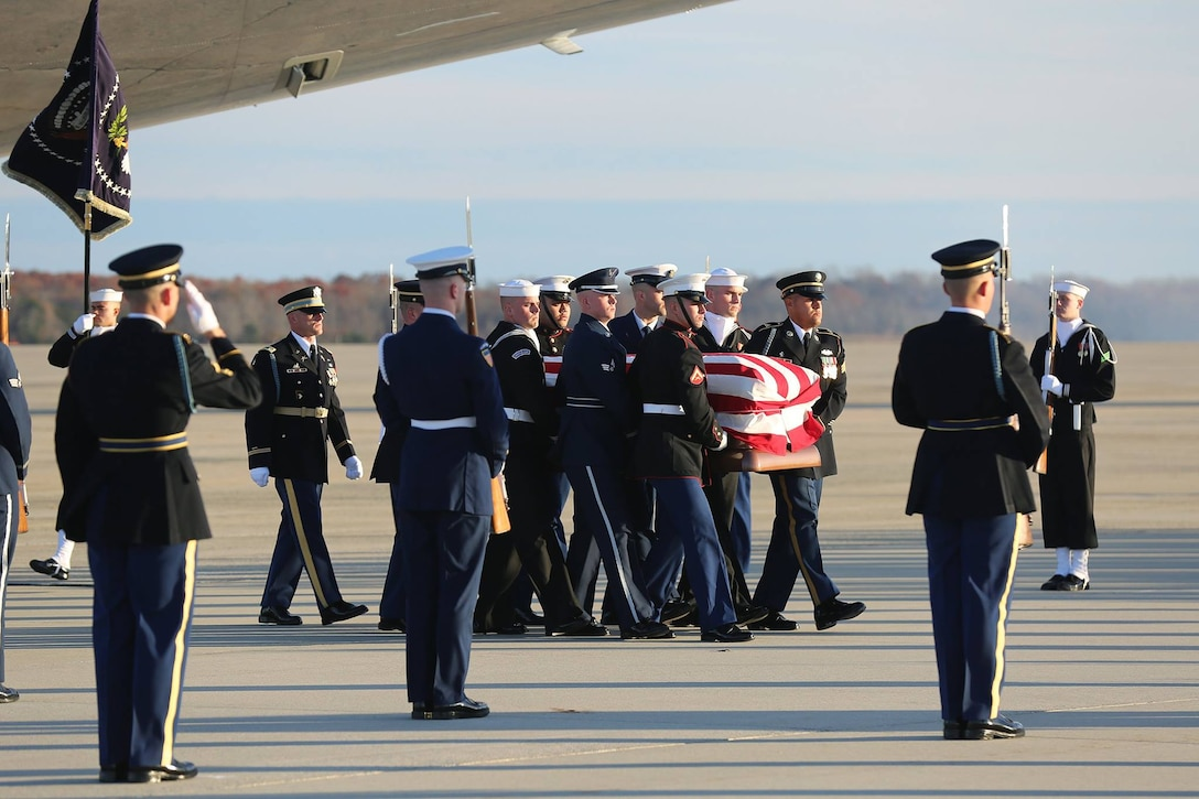 U.S. service members prepare to place the casket of George H.W. Bush, 41st President of the United States, into a hearse, Joint Base Andrews, Maryland, Dec. 03, 2018.