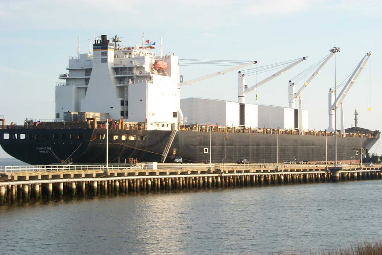 A large ship sits at a dock.