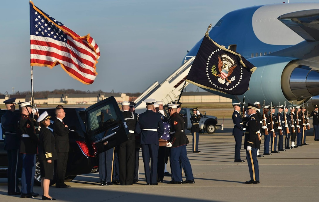 Members of the Joint Service Arrival Team place the casket of George W.H. Bush into a hearse on Joint Base Andrews, Md., Dec. 3, 2018.