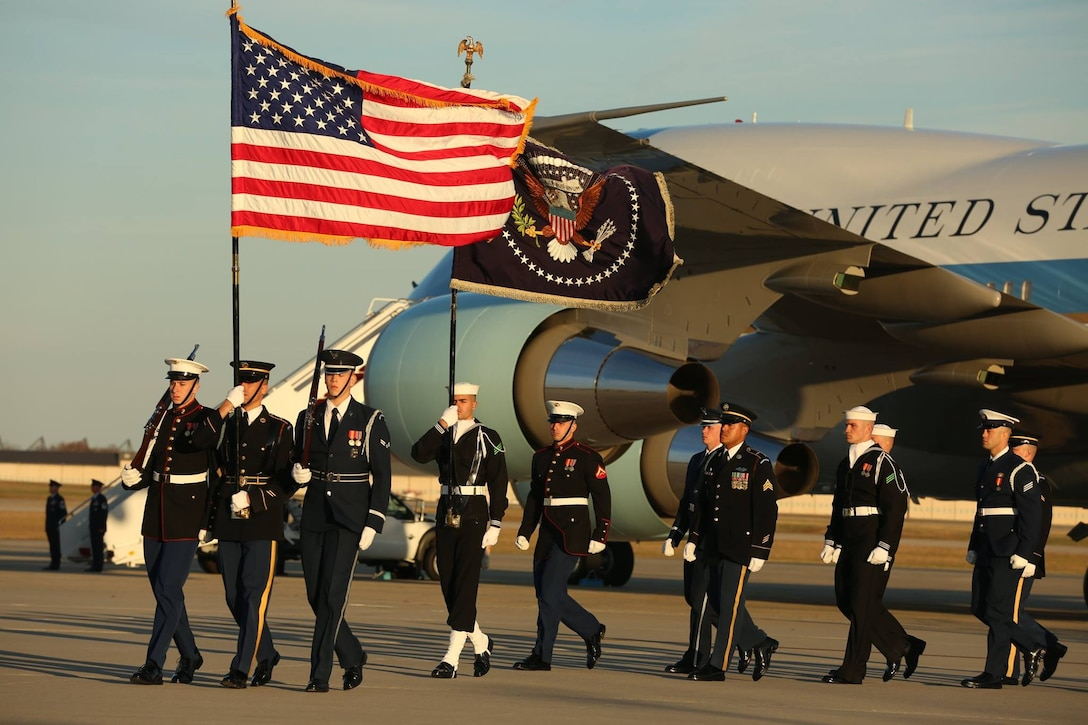 U.S. service members with the Ceremonial Honor Guard march off as the casket of George H. W. Bush, the 41st President of the United States,departs Andrews Air Base, Md., Dec. 03, 2018.