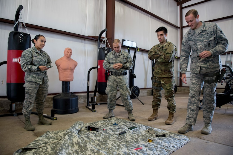 Members of the 97th Security Forces Squadron staff support team memorized items they had to recall after a timed competition at the new Warrior Training Center