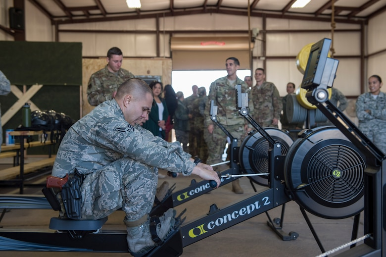 Members of the 97th Security Forces Squadron staff support team utilize rowing machines