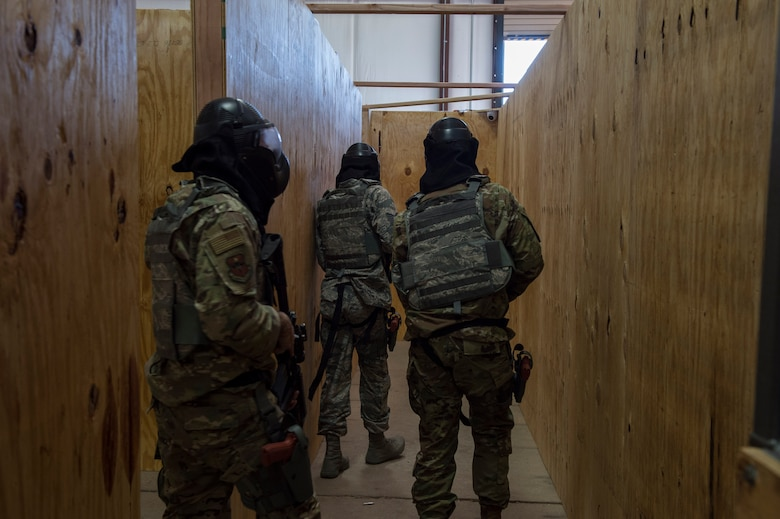 "Members of the 97th Force Support Squadron team undergo a ""shoot or don't shoot"" scenario"