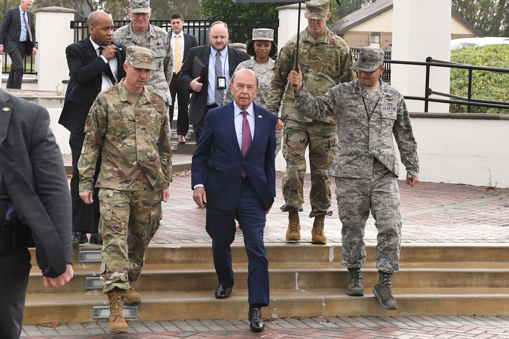 Deputy Joint Force Space Component Commander Maj. Gen. Stephen Whiting (left) walks with U.S. Secretary of Commerce Wilbur Ross (center) during a visit at Vandenberg AFB, Calif., Nov. 29, 2018. Secretary Ross met with service members from the 18th Space Control Squadron, Combined Space Operations Center, Joint Force Space Component Command and U.S. Strategic Command to discuss Space Situational Awareness capabilities and space operations during a visit here Nov. 29-30. Secretary Ross also spoke with service members about the Department of Defense transitioning non-military aspects of Space Situational Awareness and space safety monitoring and responsibilities to the Department of Commerce. (U.S. Air Force photo by Maj. Cody Chiles)