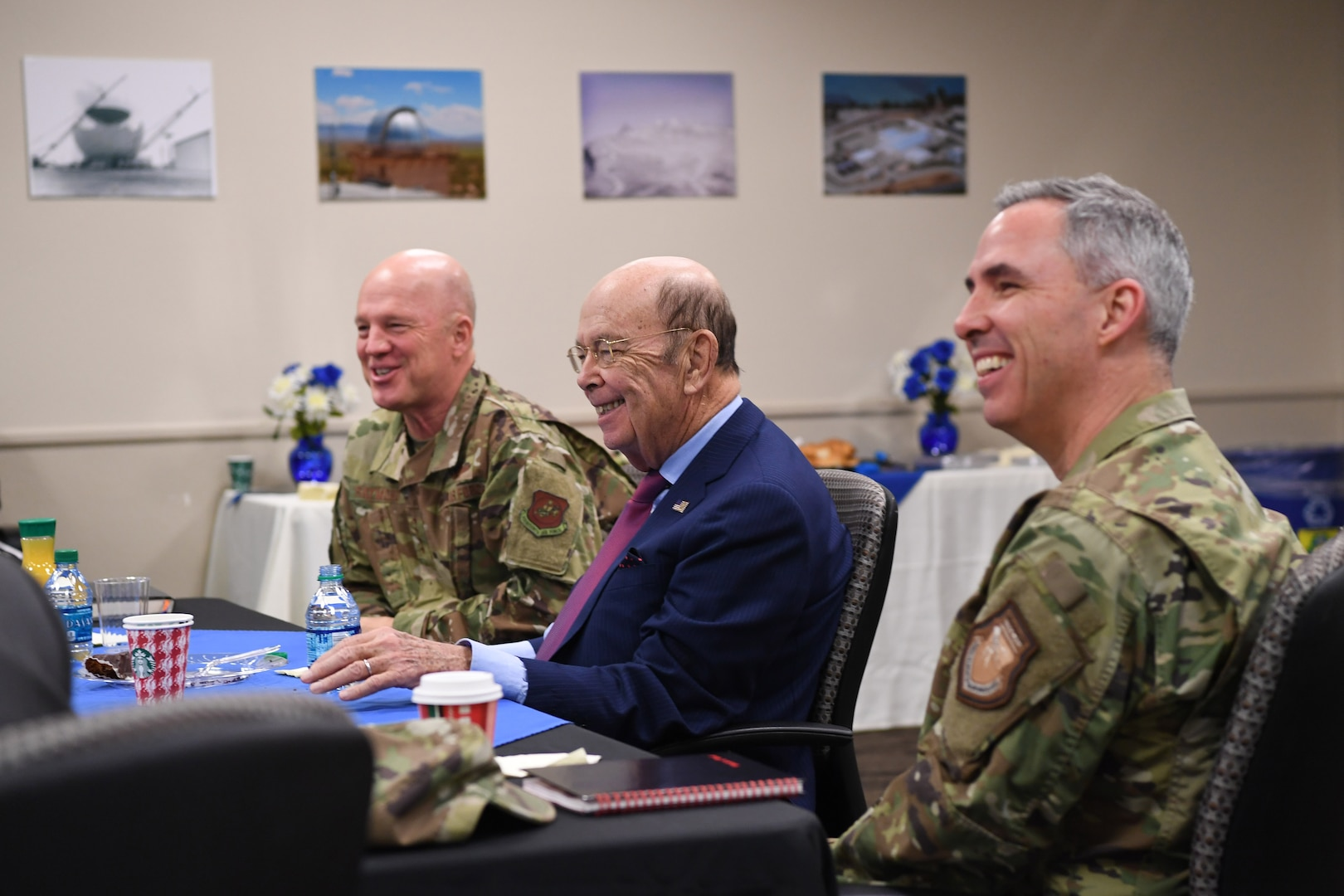 U.S. Secretary of Commerce Wilbur Ross (center), Joint Force Space Component Commander Gen. Jay Raymond (left), and Deputy Joint Force Space Component Commander Maj. Gen. Stephen Whiting (right) receiving a briefing about www.space-track.org in the Combined Space Operations Center at Vandenberg AFB, Calif., Nov. 30, 2018. Secretary Ross met with service members from the 18th Space Control Squadron, Combined Space Operations Center, Joint Force Space Component Command and U.S. Strategic Command to discuss Space Situational Awareness capabilities and space operations during a visit here Nov. 29-30. Secretary Ross also spoke with service members about the Department of Defense transitioning non-military aspects of Space Situational Awareness and space safety monitoring and responsibilities to the Department of Commerce. (U.S. Air Force photo by Maj. Cody Chiles)