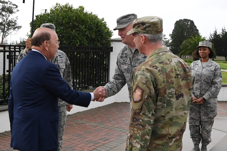 30th Space Wing Commander Col. Michael Hough (center) greets U.S. Secretary of Commerce Wilbur Ross (left) during a visit at Vandenberg AFB, Calif., Nov. 29, 2018. Secretary Ross met with service members from the 18th Space Control Squadron, 30th Space Wing, Combined Space Operations Center, Joint Force Space Component Command and U.S. Strategic Command to discuss Space Situational Awareness capabilities and space operations during a visit here Nov. 29-30. Secretary Ross also spoke with service members about the Department of Defense transitioning non-military aspects of Space Situational Awareness and space safety monitoring and responsibilities to the Department of Commerce. (U.S. Air Force photo by Maj. Cody Chiles)
