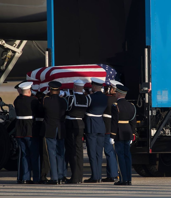 Members of the Joint Service Arrival Team carry the casket of George W.H. Bush on Joint Base Andrews, Md., Dec. 3, 2018.