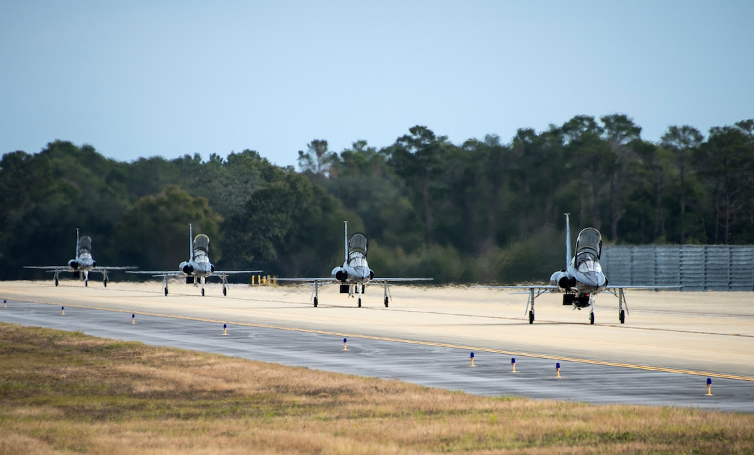 A formation of T-38 Talons fly in formation over the runway Nov. 30 at Eglin Air Force Base, Fla. Seven Talons arrived here, their temporary home as part of a mission shift by the Air Force as Hurricane Michael recovery efforts continue at Tyndall. The 2nd FS is one of two T-38 Talon adversary squadrons. They provide air-to-air threat replication to support F-22 Raptor combat and formal training squadrons. The squadron also maintains readiness to augment worldwide combat operations.