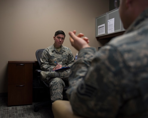 Airman 1st Class Ryland Brown, 92nd Medical Group Mental Health technician, interviews an Airman to find how to best assist his unique situation at Fairchild Air Force Base, Washington, November 11, 2018. Mental health challenges are relatively common within civilian and military communities alike. Similarly, not addressing these challenges may jeopardize a person's health and career if not prevented or treated early. (U.S. Air Force photo/Airman 1st Class Whitney Laine)
