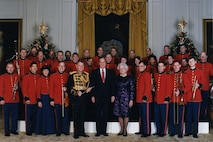 President George H.W. Bush and Mrs. Barbara Bush, with Col. John Bourgeois and members of the Marine Chamber Orchestra at a holiday reception on Dec. 12, 1990. (official White House photo)