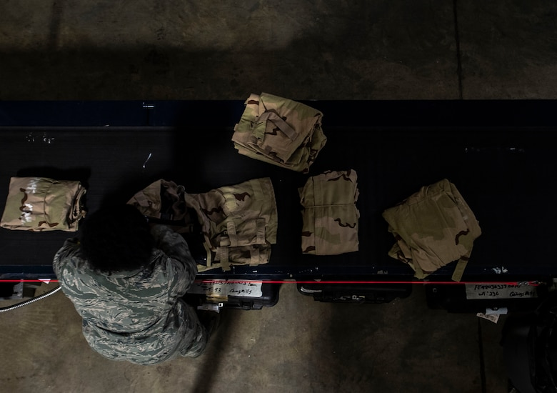U.S. Air Force Senior Airman Shanice Smith, 20th Logistics Readiness Squadron individual protective equipment (IPE) journeyman, organizes various pieces of mission oriented protective posture gear at Shaw Air Force Base, S.C., Nov 30, 2018.