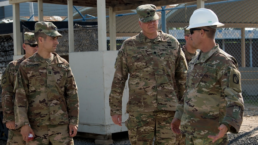 U.S. Army Chief Warrant Officer 2 Vernon Burge, right, a construction engineering technician with the 150th Brigade Engineer Battalion, Mississippi Army National Guard, shows U.S. Army Lt. Col. Filoso, center, the director of Area Support Group-Kuwait's Directorate of Public Works, water damage caused by heavy rainfall and flooding in a barracks area at Kuwait Naval Base, Kuwait, Nov. 30, 2018. The ASG-KU DPW team has worked continuously to restore living areas to safe conditions for personnel.
