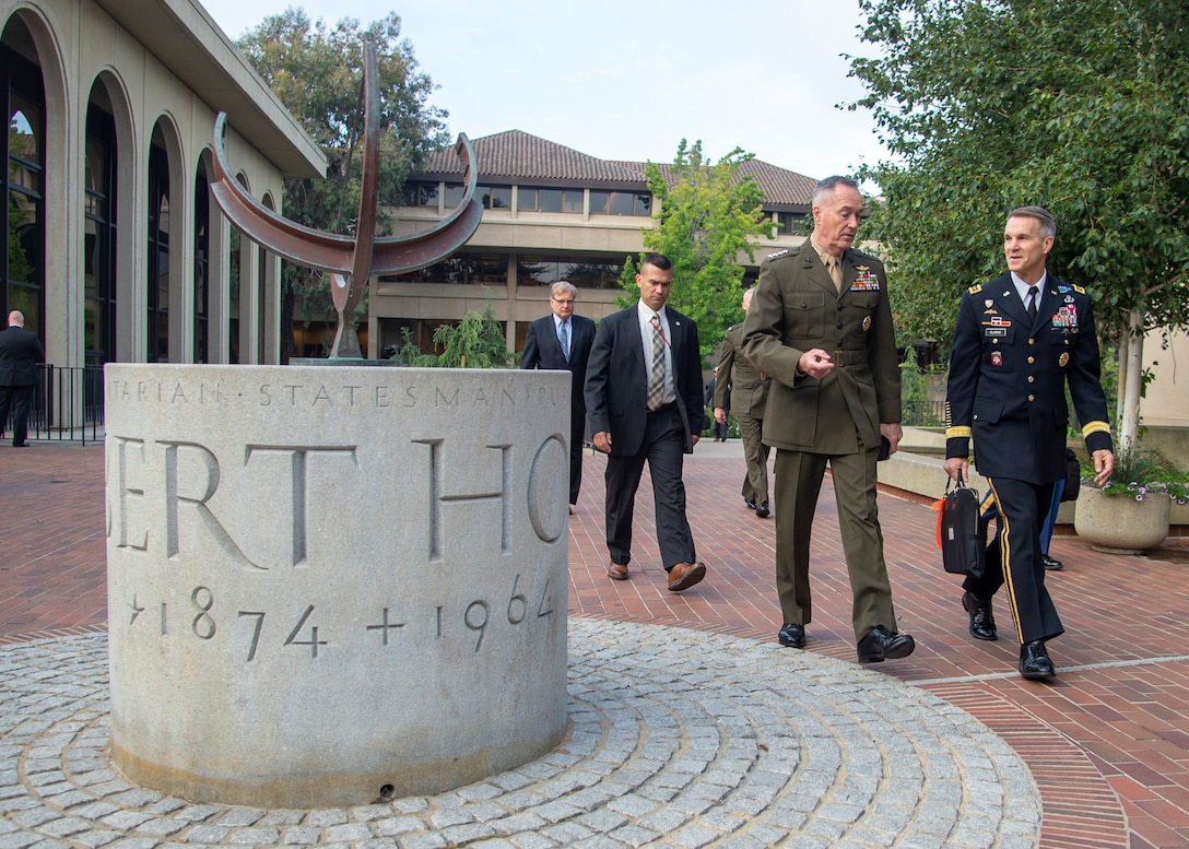Marine Corps Gen. Joe Dunford, chairman of the Joint Chiefs of Staff, walks with Army Lt. Gen. Richard D. Clarke, director for strategic plans and policy on the Joint Staff, to the Australia-United States Ministerial Consultation at the Hoover Institute at Stanford University in Palo Alto, California.