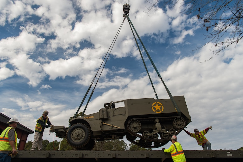 Contractors lower a M16 Multiple Gun Motor Carriage Half-track onto a flat car at the U.S. Army Transportation Museum at Joint Base Langley-Eustis, Virginia, Dec. 3, 2018.