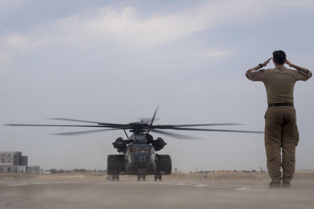 A Navy MH-53E Sea Dragon helicopter lands at Sakhir Air Base, Bahrain.