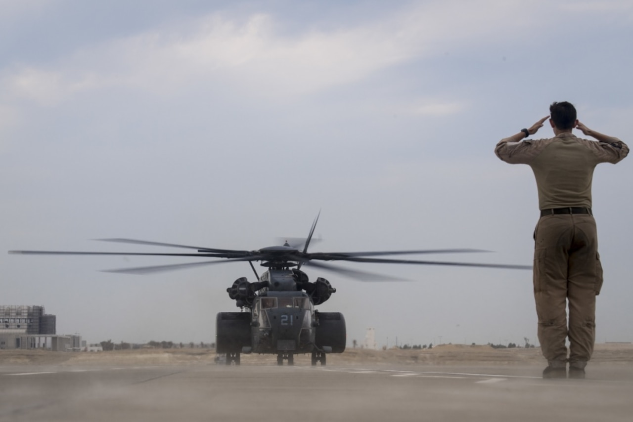 A Navy MH-53E Sea Dragon helicopter lands at Sakhir Air Base, Bahrain.