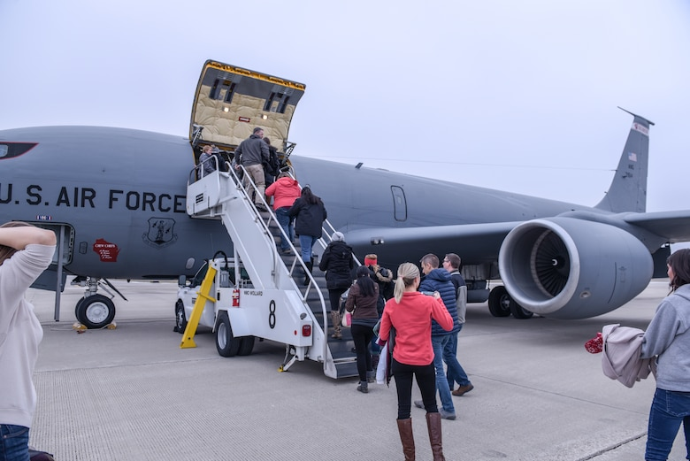 Spouses of 115th Fighter Wing Airmen were given the opportunity to fly along with 128th Air Refueling Wing crew members during a refueling training mission Nov. 30, 2018, Truax Field, Wis. Spouses begin the boarding one of two KC-135s. (U.S. Air National Guard photo by Tech. Sgt. Mary E. Greenwood)