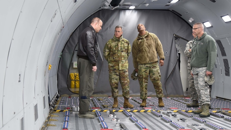 "Maj. Gen. Randall A. Ogden, 4th Air Force commander, and Chief Master Sgt. Timothy White, 4th Air Force command chief, tour the KC-46 Fuselage Trainer Dec. 1, 2018, McConnell Air Force Base, Kan. The tour was followed by a trip to the KC-46 Simulator, where Ogden and White ""flew"" over Waikiki Beach."