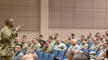 Chief Master Sgt. Timothy White, 4th Air Force command chief, speaks with Airmen of the 931st Air Refueling Wing during an all call Dec. 2, 2018, McConnell Air Force Base, Kan. During the all call, Airmen addressed any questions or concerns they had about the future of the Air Force Reserve.