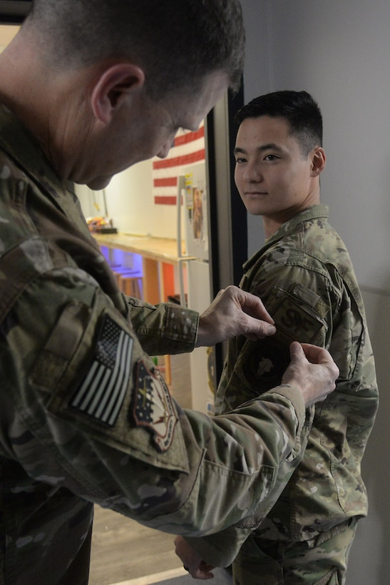Second Lt. Kojiro Kobayashi, 841st Missile Security Forces Squadron flight commander, receives his raven patch from Col. Aaron Guill, 341st Security Forces Group commander Nov. 7, 2018, at Malmstrom Air Force Base, Mont. Upon graduation, Kobayashi became the 2729th raven since the implementation of the phoenix raven program in 1997. (U.S. Air Force photo by Airman 1st Class Tristan Truesdell)