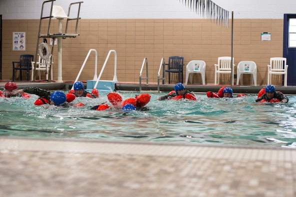 U.S. Air Force members practice different swimming techniques