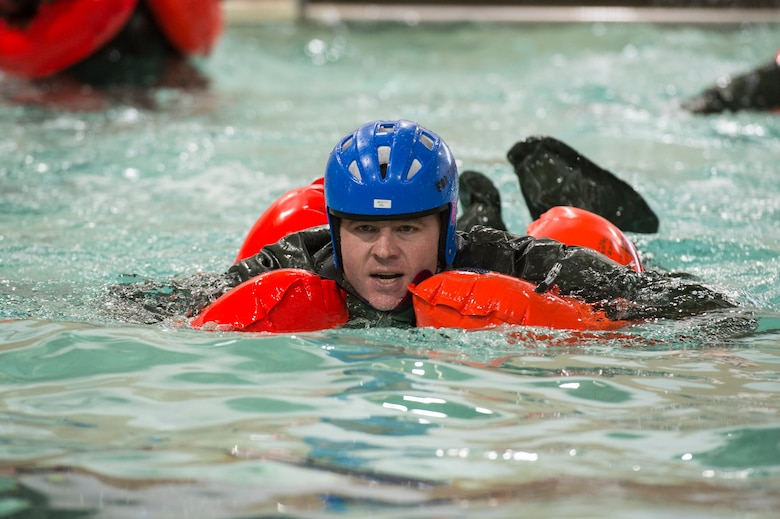 U.S. Air Force Senior Master Sgt. Pat Martin, a simulator certification boom operator assigned to the Air Mobility Command, practices his front crawl swimming stroke during a water survival refresher course,