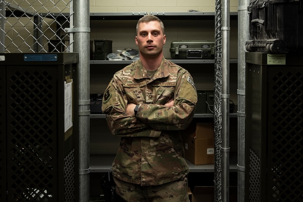 "Staff. Sgt. Corey Freundner, 47th Security Forces Squadron Combat Arms Instructor, stands amongst the weapons storage at Laughlin Air Force Base, Texas' combat arms firing range, Dec. 3, 2018. For his work with the junior deployment event, conducting the base's first heavy weapons training in eight years, setting up the range for future expansion, and for growing his knowledge on operating a firing range, Freudner has earned the ""XLer of the Week"" for the week of Nov. 26, 2018. (U.S. Air Force photo by Senior Airman Daniel Hambor)"