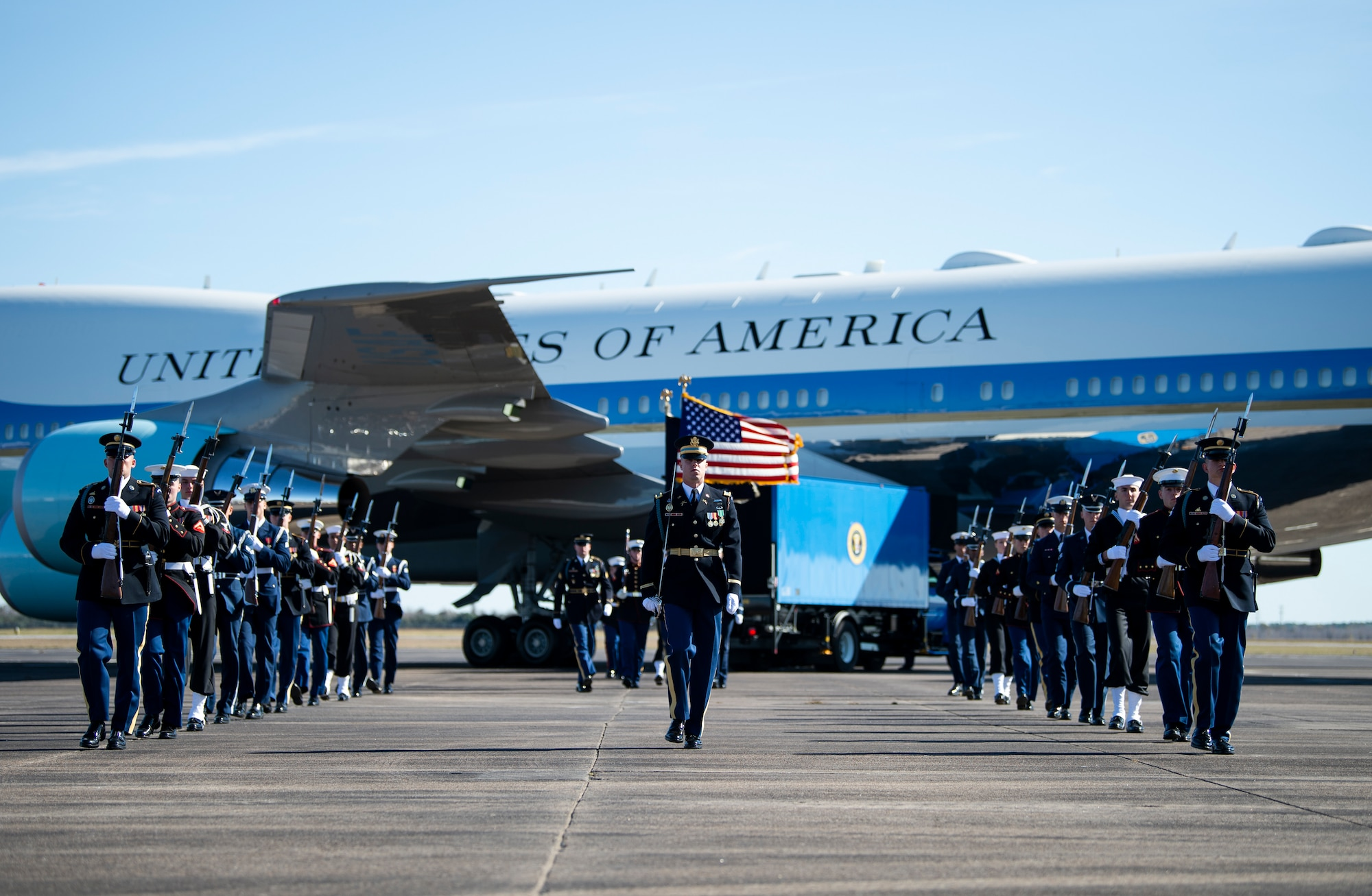 U.S. service members with the Joint Forces Honor Guard participate in a departure ceremony for former President George H.W. Bush A military honor guard walks off after taking part in a departure ceremony honoring former President George H.W. Bush in front of the Special Air Mission 41 plane at Ellington Field Joint Reserve Base in Houston, Texas, Dec. 3, 2018. Nearly 4,000 military and civilian personnel from across all branches of the U.S. armed forces, including Reserve and National Guard components, provided ceremonial support during George H.W. Bush's, the 41st President of the United States state funeral.  (U.S. Air Force photo by Tech Sgt. Andrew Lee)